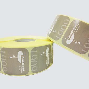 Etiquetes personalitzades de paper estucat en bobina